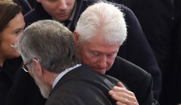 Former US President Bill Clinton hugs Sinn Fein president Gerry